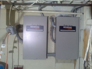 Two, wall-mounted Generac electric panels are installed adjacent to each other.